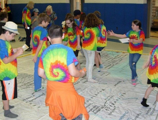4-H Youth stand on NY Giant Map